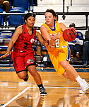 BROOKINGS, SD - NOVEMBER 12:  Sydney Palmer #32 from South Dakota State University drives with the ball against Nakiah Bell #2 from Southern Illinois Edwardsville at Frost Arena November 13, 2016 in Brookings, South Dakota. (Photo by Dave Eggen/Inertia)