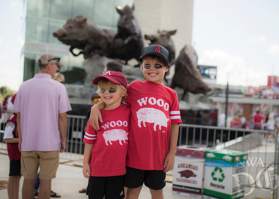 NWA Democrat-Gazette/CHARLIE KAIJO Oliver Nabirs, 5 and Sawyer Nabors, 6, of Fayetteville (from left) pose for a picture during a tailgate before the game against the Eastern Illinois Panthers, Saturday, September 1, 2018 at Razorback Stadium in Fayetteville.