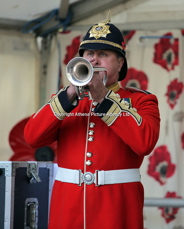 Pictured: A bugler commences the minute's silence Friday 11 November 2016<br /> Re: Remembrance Day service at Castle Square Gardens in Swansea, south Wales, UK.