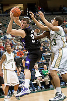 January 14, 2010:    Lipscomb center Adnan Hodzic (34) fights for a rebound against Jacksonville guard Tevin Galvin (23) during Atlantic Sun conference game action between the Jacksonville Dolphins and the Lipscomb Bisons at Veterans Memorial Arena in Jacksonville, Florida.  Jacksonville defeated Lipscomb 79-73.