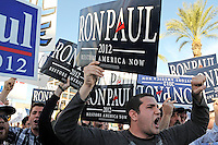 Mesa, Arizona. February 23, 2012 - As Republican candidates debated in the Mesa Arts Center, protesters including undocumented students, tea partiers, occupy movement members and Syrian president opponents, shouted slogans and held up signs and placards outside. In this photograph, Chris Jackson and other supporters of U.S. Republican presidential candidate Ron Paul demonstrate outside the complex where Paul debated with Mitt Romney, Rick Santorum, and Newt Gingrich in the city of Mesa. Photo by Eduardo Barraza © 2012