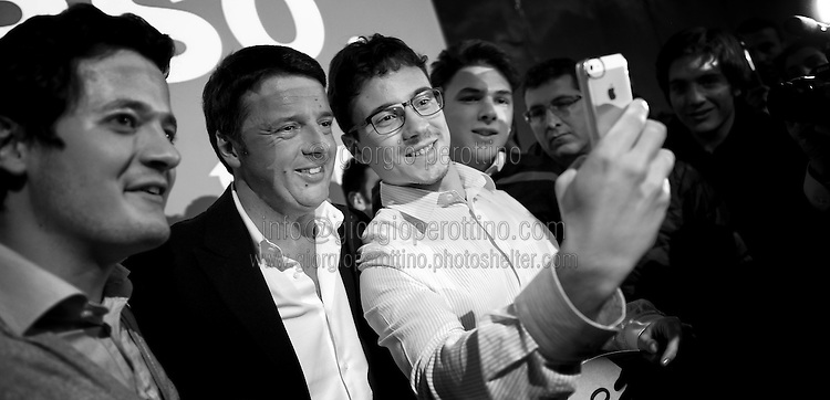 Matteo Renzi takes a selfie with some supporters using an iphone during his political campaign convention for the Partito Democratico's primary elections -Italian left wing Party-  in Turin, October 21, 2012.