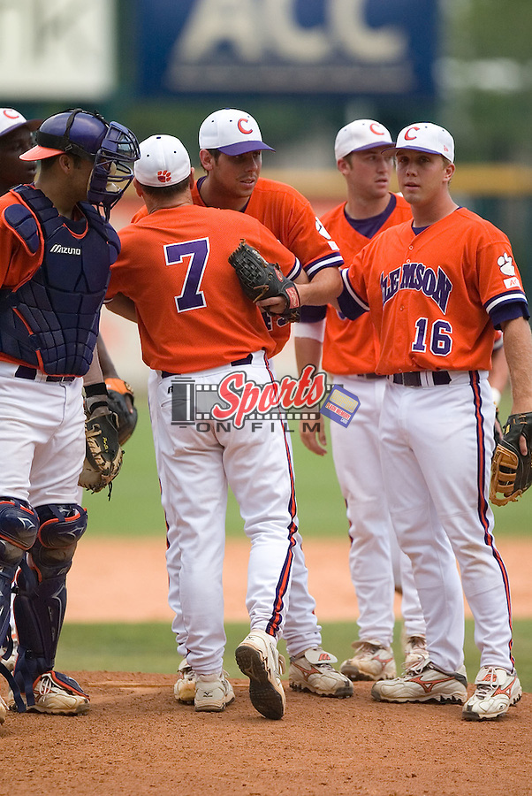 Clemson starting pitcher Sean Clark receives a hug from head coach Jack Leggett (7) after giving the Tigers 8 innings of 4-hit baseball versus North Carolina State in the Championship of the 2006 ACC Baseball Tournament at the Baseball Grounds at Jacksonville in Jacksonville, FL, Sunday, May 28, 2006.