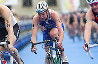 11 SEP 2010 - BUDAPEST, HUN - Alistair Brownlee battles the weather on his way to victory at the 2010 Elite Mens ITU World Championship Series Triathlon final (PHOTO (C) NIGEL FARROW)