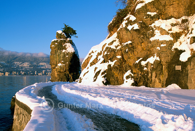 "Stanley Park, Vancouver, BC, British Columbia, Canada, Winter - Snow Covered ""Siwash Rock"" and Stanley Park Seawall at English Bay"