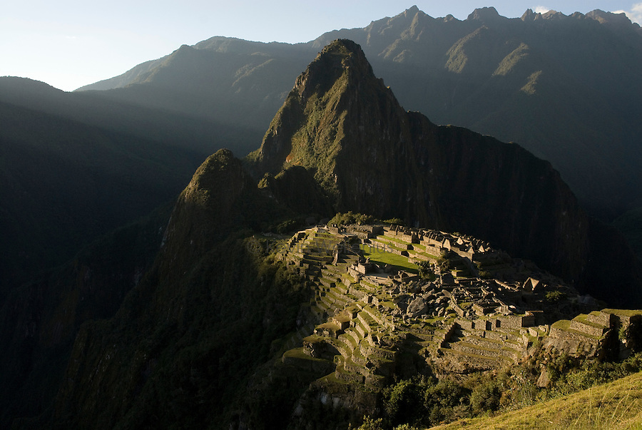 "Sunset over the ""lost city"" of Machu Picchu, approximately 75 miles NW of Cusco, Peru, with Huayna Picchu (8922') looming in the background. Machu Picchu is Peru's most important tourist destination."