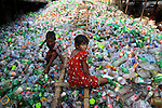 A Bangladeshi young girl works at a plastic recycling factory in Dhaka, Bangladesh. The World Day Against Child Labor, which was initiated in 2002 by the International Labor Organization or ILO to highlight the plight of child laborers, is observed across the world on June 12.