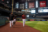 AZL D-backs starting pitcher Brennan Malone (41) walks toward the dugout with pitching coach Rich Sauveur and catcher Sandy Martinez (34) before making his professional debut in an Arizona League game against the AZL Giants Black on July 28, 2019 at Chase Field in Phoenix, Arizona. AZL Giants Orange defeated AZL D-backs 6-4. (Zachary Lucy/Four Seam Images)