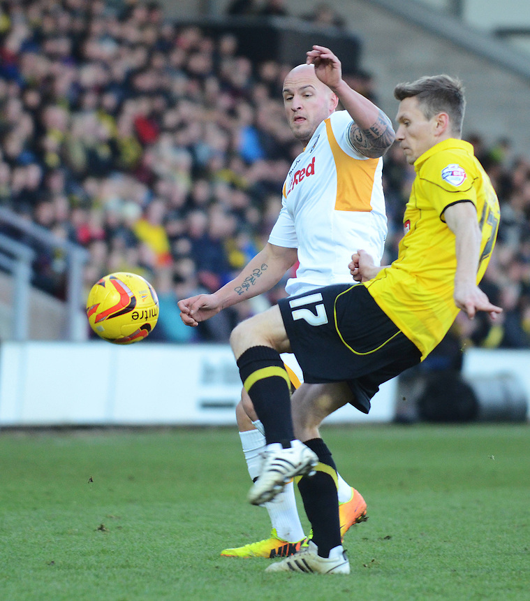 Newport County's David Pipe puts Burton Albion's Jimmy Phillips under pressure<br /> <br /> Photo by Kevin Barnes/CameraSport<br /> <br /> Football - The Football League Sky Bet League Two - Burton Albion v Newport County - Sunday 29th December 2013 - Pirelli Stadium - Burton upon Trent<br /> <br /> &copy; CameraSport - 43 Linden Ave. Countesthorpe. Leicester. England. LE8 5PG - Tel: +44 (0) 116 277 4147 - admin@camerasport.com - www.camerasport.com