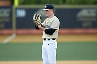 Wake Forest Demon Deacons relief pitcher William Fleming (38) looks to his catcher for the sign against the Virginia Cavaliers at David F. Couch Ballpark on May 19, 2018 in  Winston-Salem, North Carolina. The Demon Deacons defeated the Cavaliers 18-12. (Brian Westerholt/Four Seam Images)