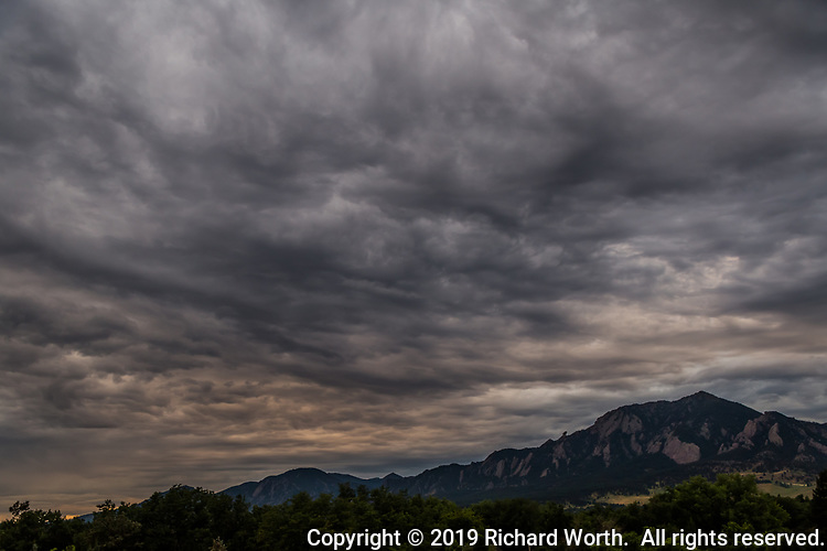 Ominously beautiful clouds soar over the foothills west of Boulder Colorado
