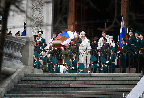 The coffin of former Russian President Boris Yeltsin is carried out of the Church of Christ Our Saviour after his funeral in Moscow, two days after his death from a heart failure. He was 76.
