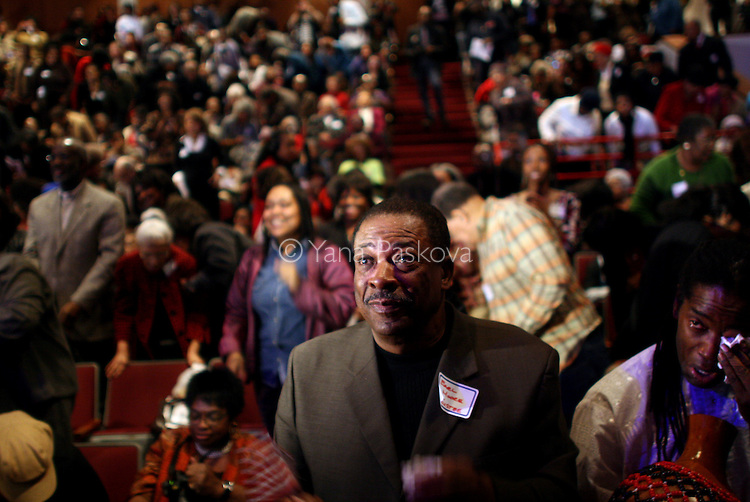"(L-R) Earl Moore, 64, on the Board of Trustees for DuSable, and Malik Camara, 47, teacher , (both from Chicago,) cries while watching the inauguration of Barack Obama as President of the United States in the theater of the DuSable Museum of African-American History in Chicago, Illinois, on the Presidential Inauguration Day, Tuesday, January 20, 2009.  Camara said, ""I expect Obama to stay grounded, spiritually, mentally, and physically, because a lot in his job will be overwhelming, but as long as he stays grounded, he will be okay."" Camara's phone number: 773.239.1771 (Photo by Yana Paskova for The New York Times)..Assignment ID: 30075164A"