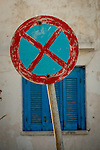 Weathered No Parking sign and blue shutter, Oia, Santorini.