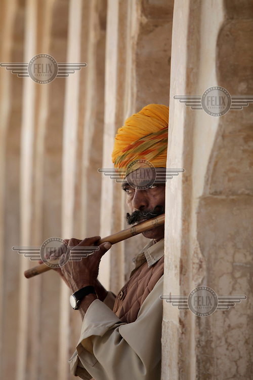 A guard plays a flute in Mehrangarh Fort, located in Jodhpur city in Rajasthan state, one of the largest forts in India.