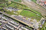 Nederland, Noord-Holland, Amsterdam, 09-04-2014;<br /> Detail Cultuurpark Westergasfabriek en Westerpark op het voormalige  Westergasterrein, langs de Haarlemmertrekvaart en de Haarlemmerweg. Links van het kanaal woonwijk de multiculturele Staatsliedenbuurt. Spoorbanen rechts. en boven in beeld Spaarndammerbuurt.<br /> Culture park Westergasfabriek and the Westerpark on the former Westergasterrein (gasworks), and residential district on the other side of the channel.<br /> luchtfoto (toeslag op standard tarieven);<br /> aerial photo (additional fee required);<br /> copyright foto/photo Siebe Swart