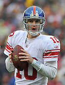 Landover, MD - November 30, 2008 -- New York Giants quarterback Eli Manning (10) looks downfield for a receiver in second quarter action against the Washington Redskins at FedEx Field in Landover, Maryland on Sunday, November 30, 2008..Credit: Ron Sachs / CNP.(RESTRICTION: No New York Metro or other Newspapers within a 75 mile radius of New York City)