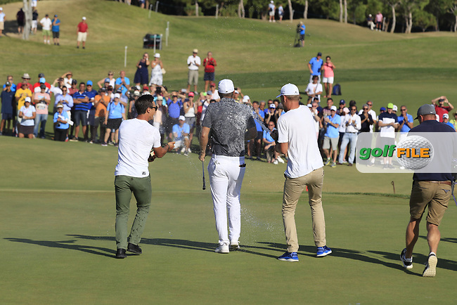Thorbjorn Olesen (DEN) invades the 18th green to celebrate with Lucas Bjerregaard (DEN) after sinking the winning putt at the 2017 Portugal Masters, Dom Pedro Victoria Golf Course, Vilamoura, Portugal. 24/09/2017<br /> Picture: Fran Caffrey / Golffile<br /> <br /> All photo usage must carry mandatory copyright credit (&copy; Golffile | Fran Caffrey)