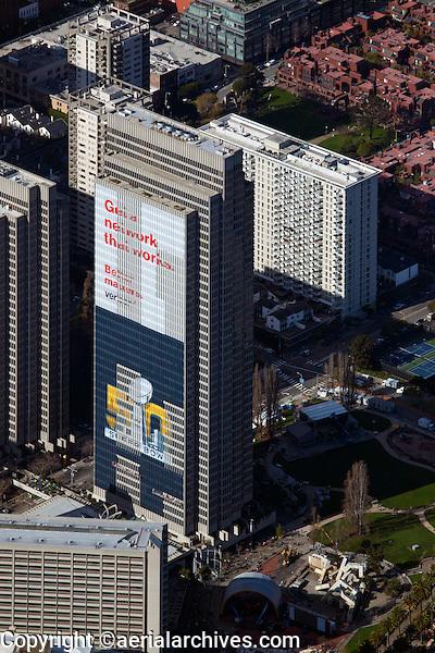 aerial photograph Embarcadero Center, Tower Four with Verizon Banner begin put up, during Superbowl 50, San Francisco, California