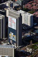 aerial photograph Embarcadero Center, Tower Four with Verizon Banner begin put up, during Superbowl 50, San Francisco, California