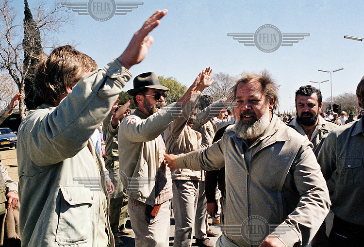 Eugene Terre'Blanche receives a salute from members of the Afrikaner Weerstandsbeweging (AWB - Afrikaner Resistance Movement).