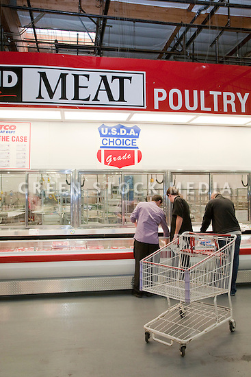 Customers shopping at meat and poultry section at Costco selling USDA Choice Grade Beef (USDA = United States Department of Agriculture). Costco, California, USA
