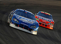 Apr 22, 2006; Phoenix, AZ, USA; Nascar Nextel Cup driver Kurt Busch of the (2) Miller Lite Dodge Charger leads Jeff Gordon during the Subway Fresh 500 at Phoenix International Raceway. Mandatory Credit: Mark J. Rebilas-US PRESSWIRE Copyright © 2006 Mark J. Rebilas..