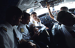 "John Travolta, captain and pilot, of his own jumbo jet, in the cockpit of his aircraft...John Travolta is pilot of his very own jumbo jet, a 1964 Boeing 707-100 series. In 2003, John Travolta flew his jumbo jet around the world, in partnership with Quantas, to rekindle confidence in commercial aviation, and to remind us that elegance and style are a part of flying. The crew are dressed in tailor made authentic uniforms from the Quantas museum. The men's uniforms are styled on British Naval uniforms and the ladies' designed by Chanel. His jumbo jet sports a personalised number plate N707JT which speaks for itself. The aircraft is named ""Jett Clipper Ella"" dedicated to his son and daughter. This jumbo together with his other aircraft are housed in purpose built hangars at his home in Florida, USA."