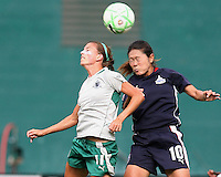 Homare Sawa #10 of the Washington Freedom goes up for a header against Angie Woznuk #11 of St. Louis Athletica during a WPS match at RFK Stadium on July 18 2009, in Washington D.C. Freedom won the match 1-0.