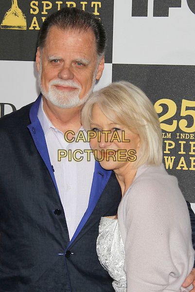 TAYLOR HACKFORD & DAME HELEN MIRREN .25th Annual Film Independent Spirit Awards - Arrivals held at the Nokia Event Deck at L.A. Live, Los Angeles, California, USA, 5th March 2010..indie half length married couple husband wife beard facial hair white silver shrug cardigan .CAP/ADM/MJ.©Michael Jade/AdMedia/Capital Pictures.
