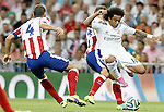 Real Madrid's Marcelo Vieira (r) and Atletico de Madrid's Mario Suarez (l) and Jose Maria Gimenez (c) during Supercup of Spain 1st match.August 19,2014. (ALTERPHOTOS/Acero)