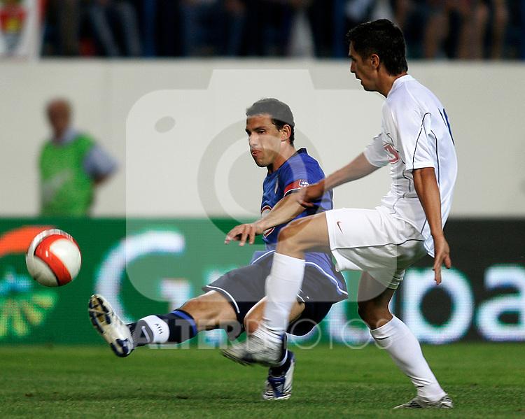 Atletico de Madrid's Maxi Rodriguez (l) and Gloria Bistrita's Turcu (r) during the Intertoto Cup match between Atletico de Madrid and Gloria Bistrita at Vicente Calderon Stadium in Madrid, Saturday July 28 2007. (ALTERPHOTOS/B.echavarri).