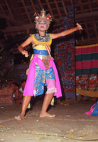 Bali, Indonesia. Ubud.  Young girl performs the traditional Ramayan dance during a performance given by local villagers in the village hall.  Music and dancing are an essential part of the Balinese culture and people of all ages remain inseparable from these traditions..