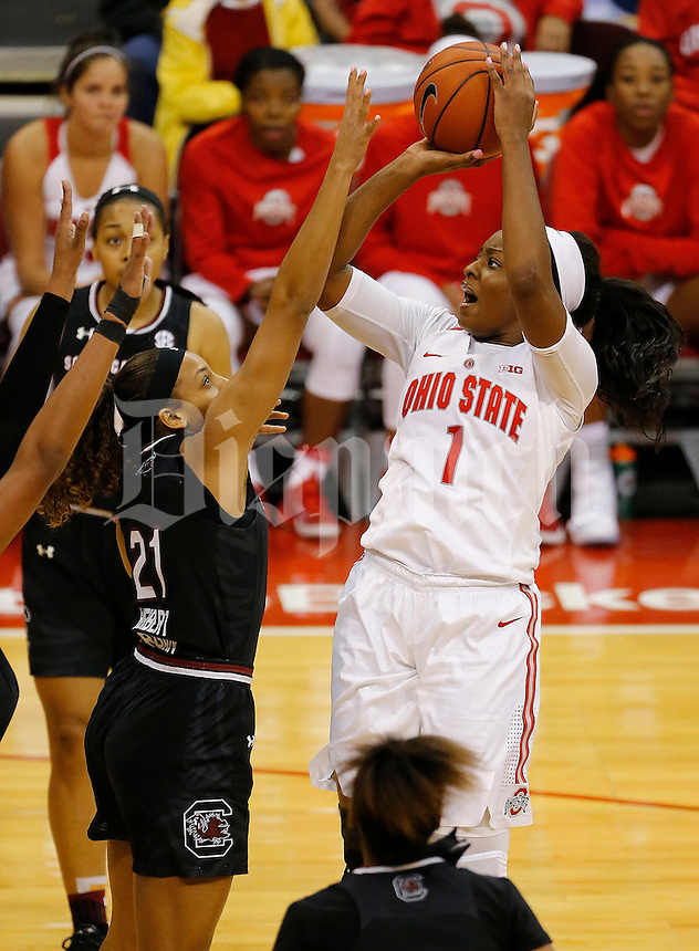 Ohio State Buckeyes forward Stephanie Mavunga (1) shoots over South Carolina Gamecocks forward Mikiah Harrigan (21) during the second half of the NCAA basketball game at Value City Arena in Columbus on Nov. 14, 2016. Ohio State lost 92-80. (Adam Cairns / The Columbus Dispatch)