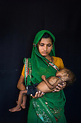 22 year old Radha Jitendra seen with her malnourished girl child, 12 month old Sangeeta Radha at the Nutrition Rehabilitation Centre (NRC) in Burhanpur district of Madhya Pradesh, India. Sangeeta was admitted to the NRC on Sept 17, 2012 and weighed 3.910Kg. Photo: Sanjit Das/Panos for ACF