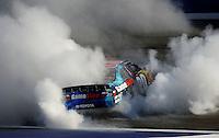 Oct. 10, 2009; Fontana, CA, USA; NASCAR Nationwide Series driver Joey Logano celebrates after winning the Copart 300 at Auto Club Speedway. Mandatory Credit: Mark J. Rebilas-