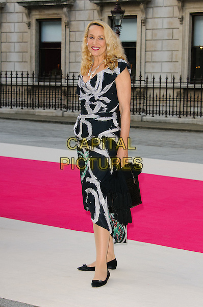 Jerry Hall.Arrivals at the Royal Academy Summer Exhibition 2012 - preview party held at the Royal Academy of Arts, London, England..May 30th, 2012.full length black dress grey gray print .CAP/CJ.©Chris Joseph/Capital Pictures.