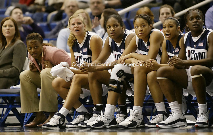 HARTFORD, CT 02 DECEMBER 2005 120105BZ18-     UConn #24, Charde Houston, left, and her teammates watch from the bench against the Hartford Hawks at the Hartford Civic Center Thursday night. <br /> Jamison C. Bazinet Republican-American
