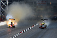 Mar. 31, 2012; Las Vegas, NV, USA: NHRA top fuel dragster driver Damien Harris (left) explodes an engine alongside Steve Chrisman during qualifying for the Summitracing.com Nationals at The Strip in Las Vegas. Mandatory Credit: Mark J. Rebilas-US PRESSWIRE