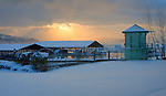 Idaho, North, Coeur d'Alene. Morning light steams over the Marina at East Tubbs Hill on a snow covered sub-zero dawn.