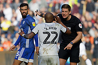 Andre Ayew of Swansea City (C) protests to referee Robert Jones (R) during the Sky Bet Championship match between Swansea City and Cardiff City at the Liberty Stadium, Swansea, Wales, UK. Sunday 27 October 2019
