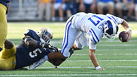 Blue Devils quarterback Daniel Jones (17) is sacked by Notre Dame Fighting Irish linebacker Nyles Morgan (5) in the third quarter.
