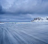 waves move across Skagsanden Beach, Flakstad, Flakstadøy, Lofoten islands, Norway