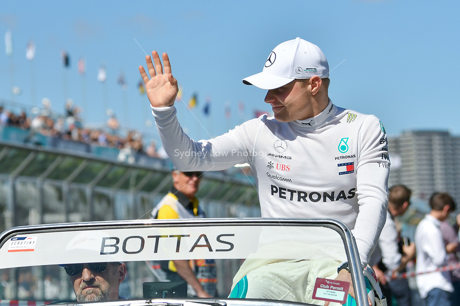 March 25, 2018: Valtteri Bottas (FIN) #77 from the Mercedes AMG Petronas Motorsport team waves to the crowd during the drivers' parade at the 2018 Australian Formula One Grand Prix at Albert Park, Melbourne, Australia. Photo Sydney Low