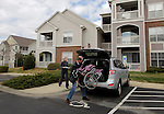 William Massart loads a wheelchair for his daughter Sandra Massart, near his wife Olga Batiounina, left, outside the family's apartment in Durham, NC, USA, on Tuesday, Feb. 14, 2012.  Sandra Massart is being treated for MLD, a degenerative condition.  Photo by Ted Richardson