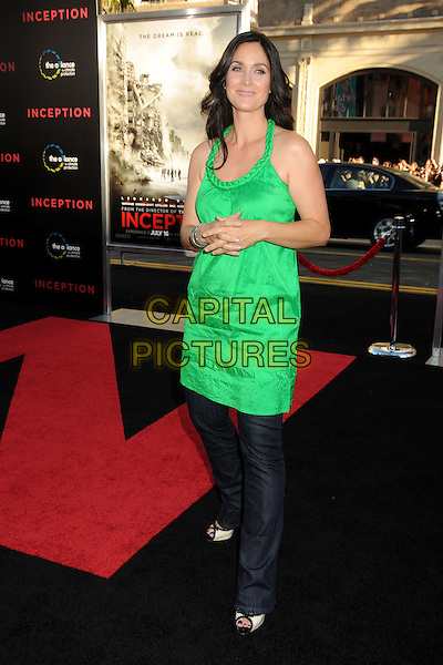 "CARRIE-ANNE MOSS .""Inception"" Los Angeles Film Premiere held at Grauman's Chinese Theatre, Hollywood, California, USA, .13th July 2010..full length tunic dress over jeans green plaited braided neckline strap .CAP/ADM/BP.©Byron Purvis/AdMedia/Capital Pictures."
