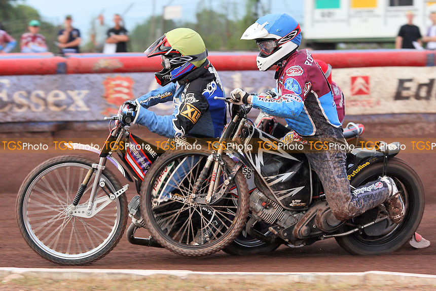 Heat 4: Stuart Robson (blue) gets in a tangle with Leon Madsen and crashes out - Lakeside Hammers vs Poole Pirates - Sky Sports Elite League Speedway at Arena Essex Raceway, Purfleet, Essex - 02/08/10 - MANDATORY CREDIT: Gavin Ellis/TGSPHOTO - Self billing applies where appropriate - Tel: 0845 094 6026