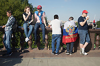 MOSCOW, RUSSIA - June 16, 2018: Russia fans take in the view just of Moscow just outside the FIFA Fan Fest at Vorobyovy Gory (Sparrow Hills) at the 2018 FIFA World Cup.