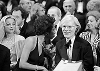 "Andy Warhol (R) and Donyale Luna (head turned) at the ""Circus of the Stars,"" (CBS Special), Santa Monica Civic Auditorium, November, 1976. Photo by John G. Zimmerman"