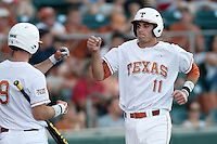 Texas Longhorns  first baseman Alex Silver #11 scores during the NCAA baseball game against the Central Arkansas Bears on April 24, 2012 at the UFCU Disch-Falk Field in Austin, Texas. The Longhorns beat the Bears 4-2. (Andrew Woolley / Four Seam Images).